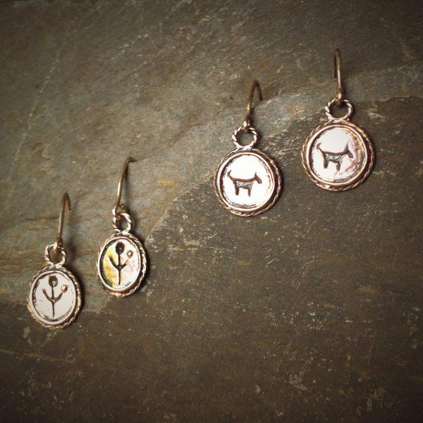 empanda symbol earrings