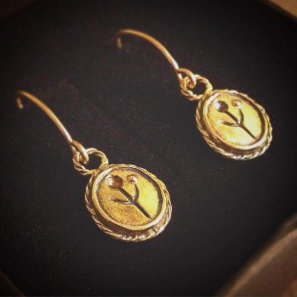gold empanda symbol earrings