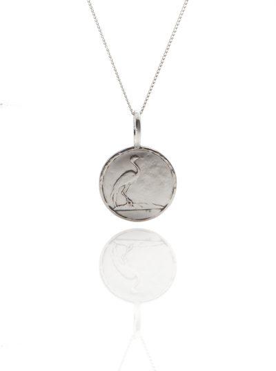 bird coin pendant
