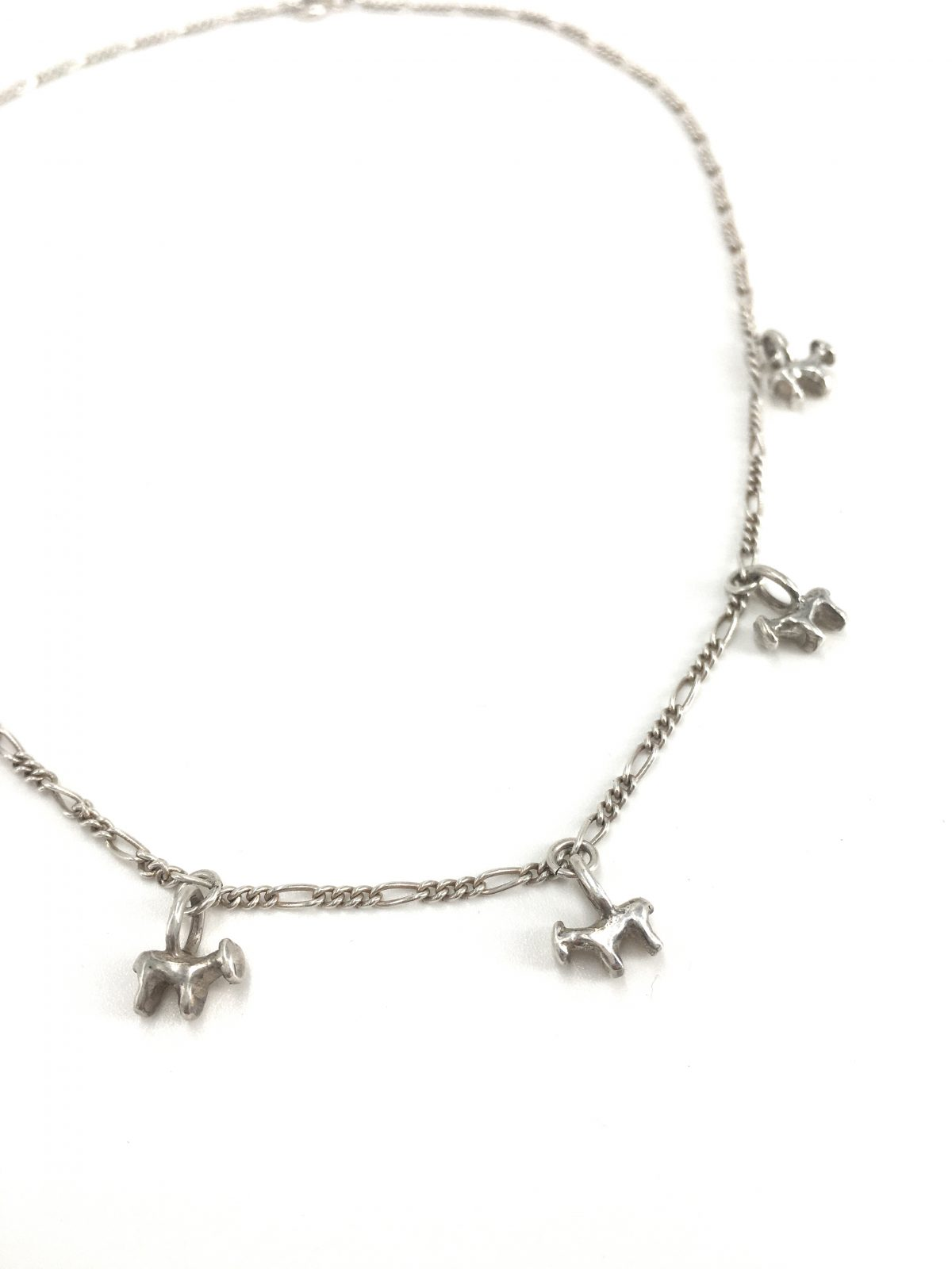 Carved animal charm necklace